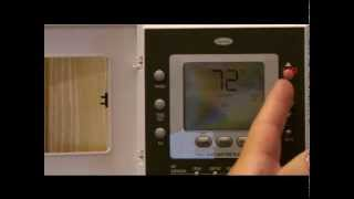 Carrier comfort thermostat button identification