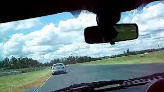 Clio RS 182 CUP vs Ford Falcon FPV Cobra edition at Queensland Raceway