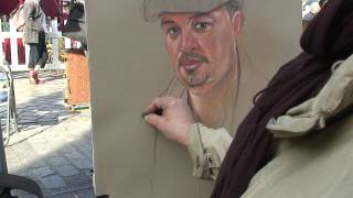 A Pastel portrait demonstration by place du tertre artist Agnes .mpg
