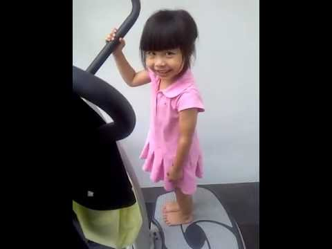 5-year-old girl having fun with the vibration machine