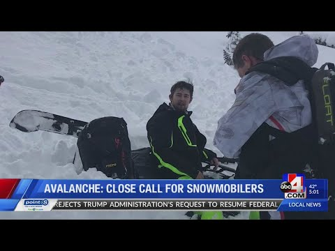 Two snowmobilers rescued after being caught in avalanche