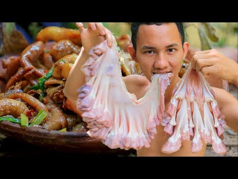 Primitive Technology: Cooking Pigs Small Intestines in the Forest