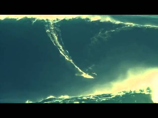 Garrett McNamara breaks world record surfing 100 foot wave!