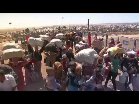 Download RAW Syrian refugees cross Turkey border Mp4 HD Video and MP3
