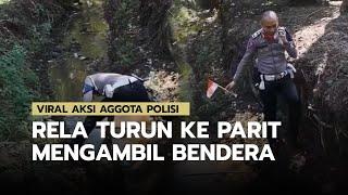 Seorang Anggota Polisi Rela Turun ke Parit Mengambil Bendera, Aksinya Diunggah di IG Ganjar Pranowo