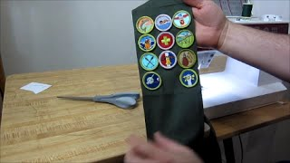 Sewing on Boy Scout Merit Badges