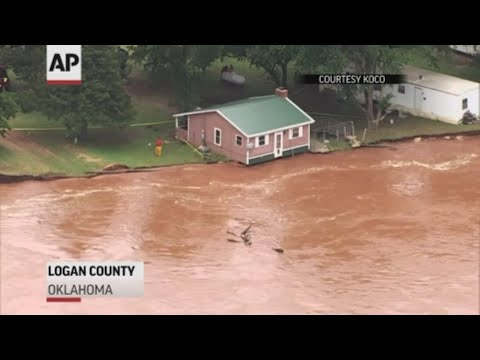 Some residents along a rain-swollen Oklahoma river are evacuating after swift currents eroded the riverbank and undermined the soil beneath their homes. (May 22)