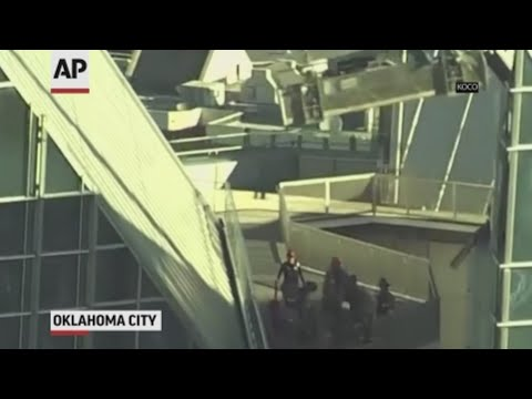 Two window washers are rescued from a scaffold above the roof of an Oklahoma City skyscraper. (May 15)