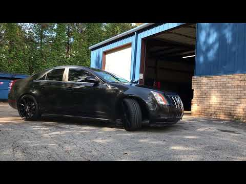 "2011 Cadillac cts sitting on black 22"" lexani pegasus wheels wrapped in 235/30-22 Lexani tires"