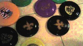 ya boy Dominoes 7's collection of Mardi Gras frisbees on the floor