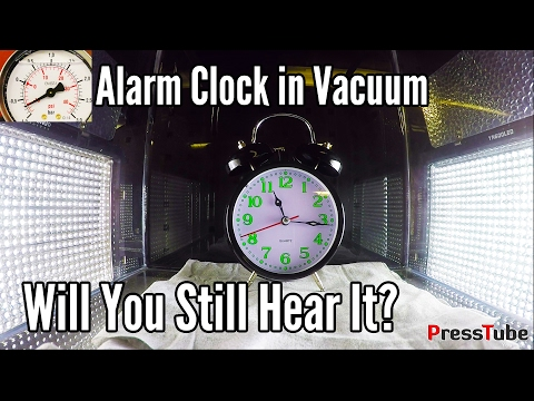 What happens when you put an alarm clock in a vacuum chamber? Will you still hear it?