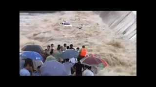 Taxi Ride Into Raging Flood waters Turns Into Dramatic Rescue