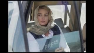 Margot Robbie as Tanya in Whiskey Tango Foxtrot (2016)