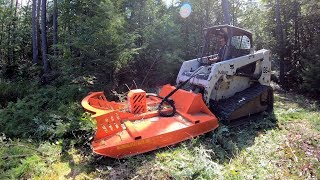 Mowing an overgrown woods road