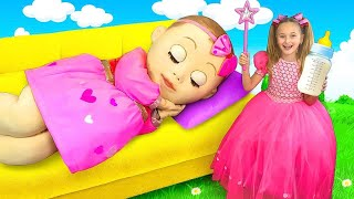 Sasha plays with a Big Baby doll