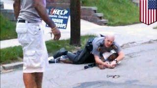 Civilian hero risks life to save cop fighting suspect resisting arrest in Cincinnati - TomoNews - Video Youtube