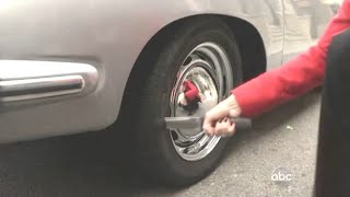 Woman slashes a tire