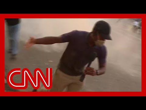 Escalating protests force CNN crew to flee to safety