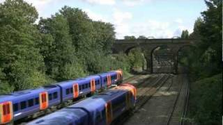 preview picture of video 'Trains seen from Oxford Road railway bridge, Putney (SW London)'