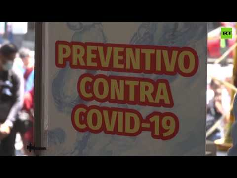 COVID-19 | Sanitizing gates 'disinfect' market visitors in Mexico