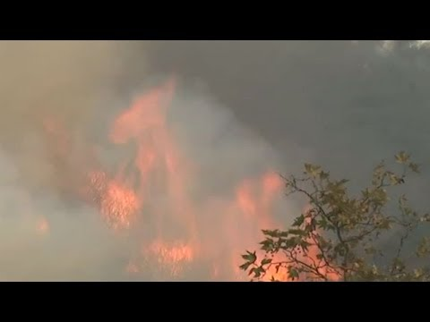 Firefighters wrestle to douse massive California wildfire