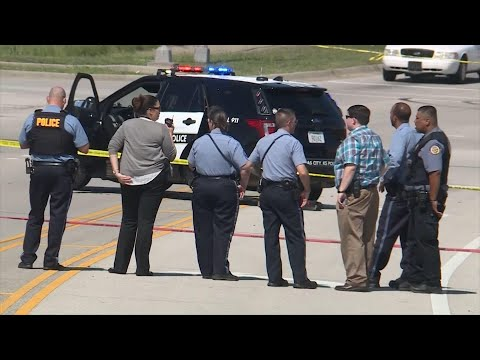 """Kansas City, Kansas police say officers shot and killed a man who had fired at them. Witnesses say the man had gone into a hotel, claimed he killed his wife, made threats and said he was """"armed and dangerous."""" (Aug. 14)"""