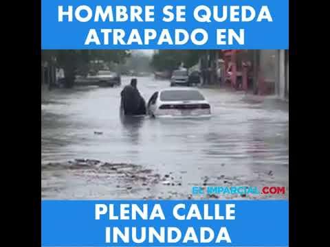 Hombre se queda atrapado en plena calle inundada en Hermosillo