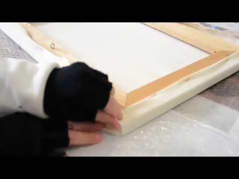 Como doblar la tela en la esquina del bastidor