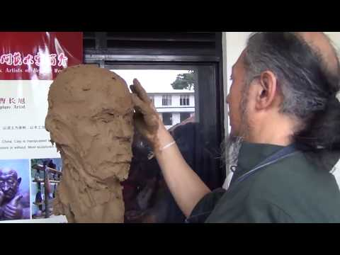 clay sculpture face by sarath chandrajeewa