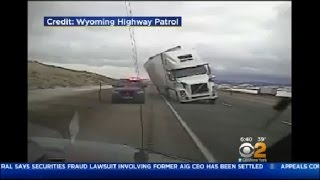 Tractor-Trailer Falls Onto Police Cruiser In Wyoming