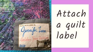 Attaching a fabric panel quilt label