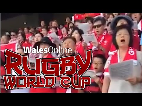 Fans in Japan sing the Welsh national anthem at the Rugby World Cup