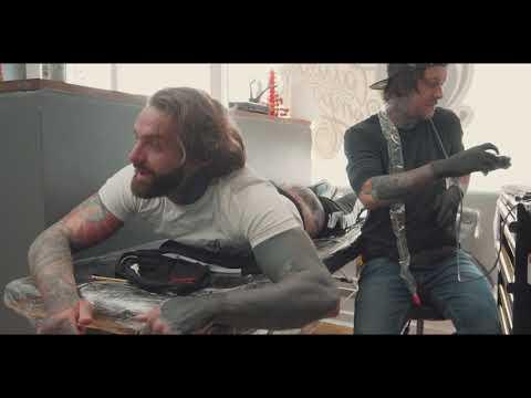 Matt Webb Tattooing Aaron Chalmers - Bum Tattoo