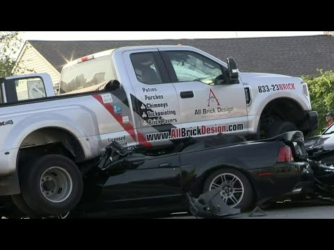Truck ends up on top of Mustang in St. Clair Shores collision