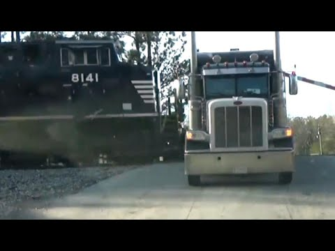 Driver Leaps to Safety as Train Crashes into Truck
