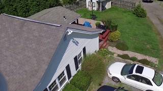 Drone footage before and after roof cleaning
