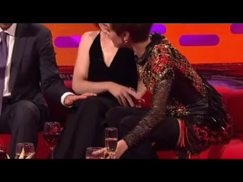 Adam Sandler repeatedly touches Claire Foy's knee... leaving her appearing to squirm