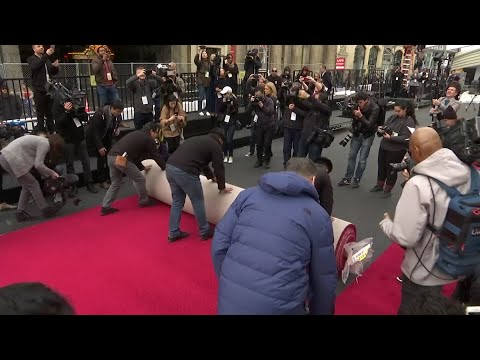 Workers rolled out the red carpet at the Dolby Theatre in Hollywood in advance of this weekend's Academy Awards. (Feb. 20)