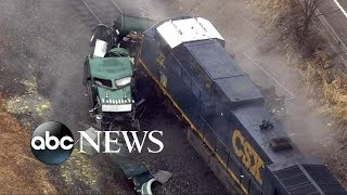 Freight train slams into tanker truck carrying hydrochloric acid