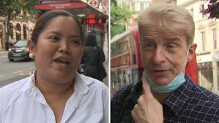 UK public reacts to wearing mandatory face masks in shops