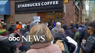 Handcuffing of 2 black men in Starbucks in Philadelphia sparks controversy
