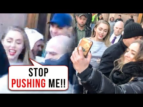 Miley Cyrus PUSHED By Fans, ESCAPES With Help Of Bodyguard