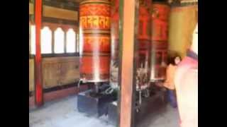 preview picture of video 'Spinning Large Prayer Wheels in Thimphu, Capital of Bhutan (video 2)'