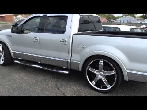 "RIMTYME HAMPTON, 2007 LINCOLN MARK LT SITTING ON 26"" AKUZA WHEELS"