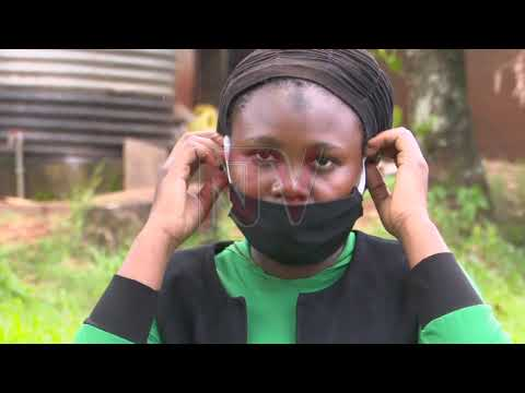 COVID-19 PANDEMIC: Health workers advise on wearing a face mask
