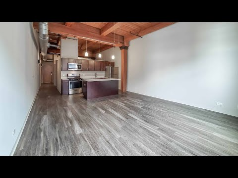 Tour a one-bedroom loft #504 at the South Loop's Carriage House Lofts