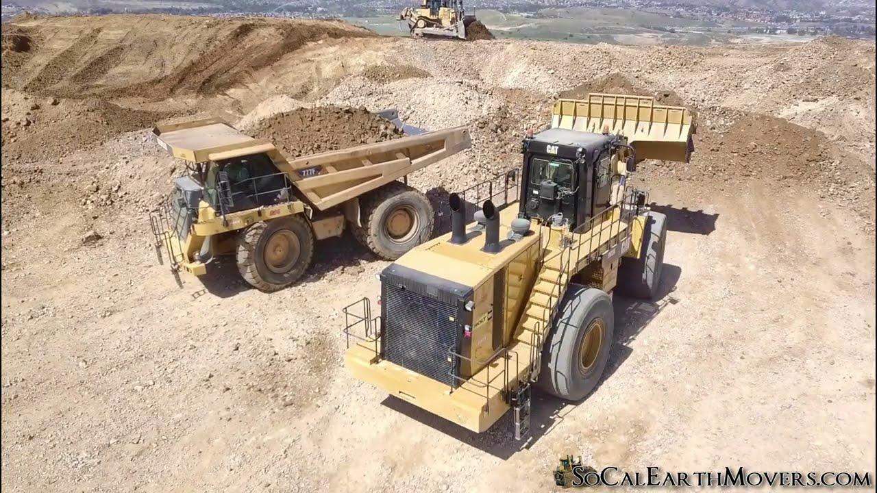 CAT 992K loading 777F haul trucks on new residential development