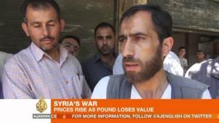 Aleppo residents struggle as Syrian pound tumbles