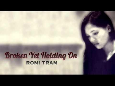 Broken Yet Holding On - Roni Tran Lyrics