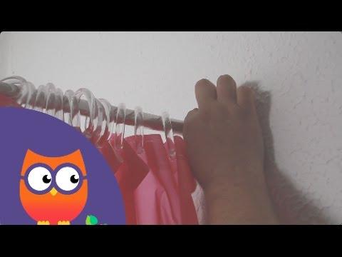 Poser un rideau de douche (Ooreka.com)